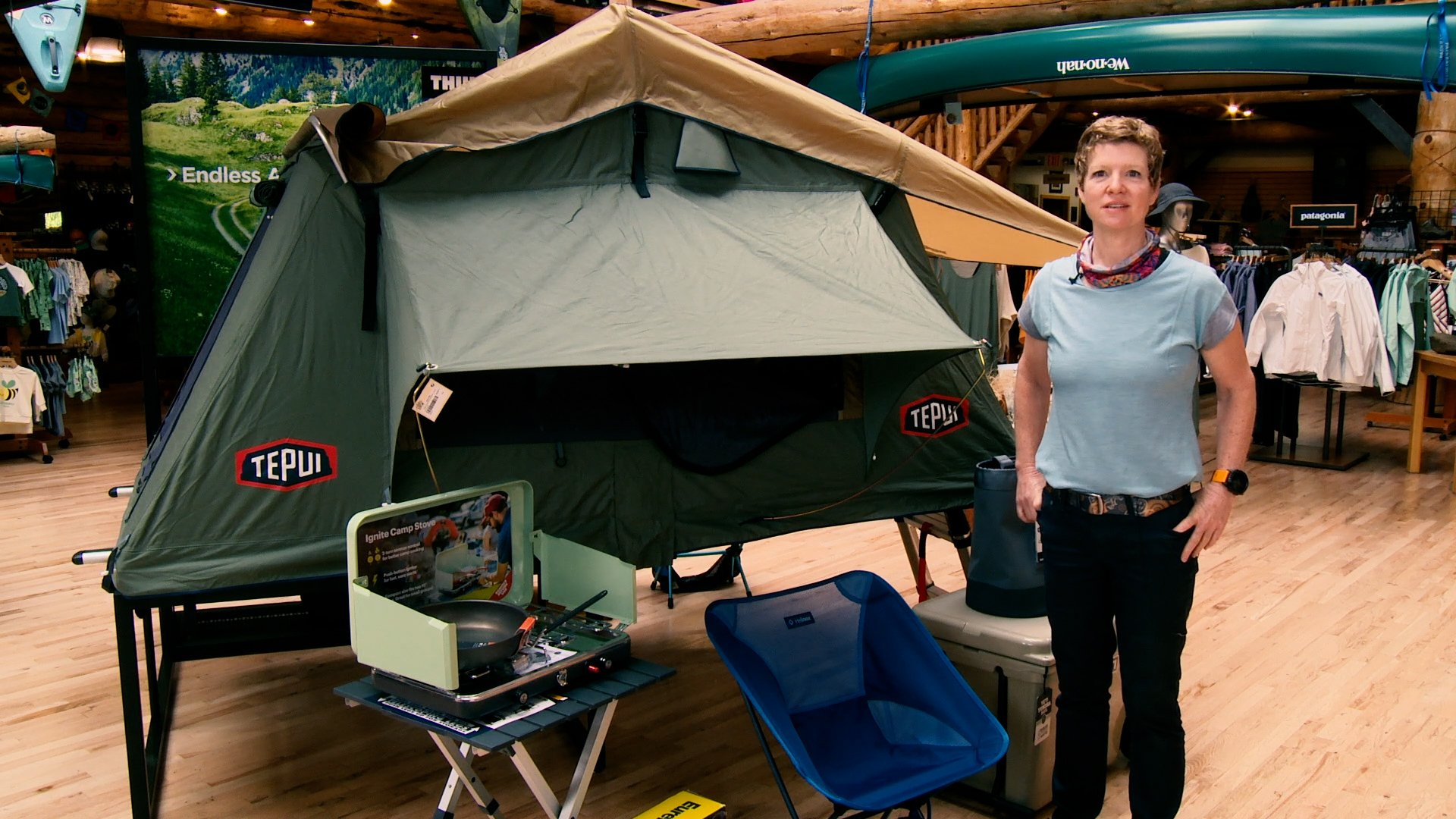 Woman in from of tent